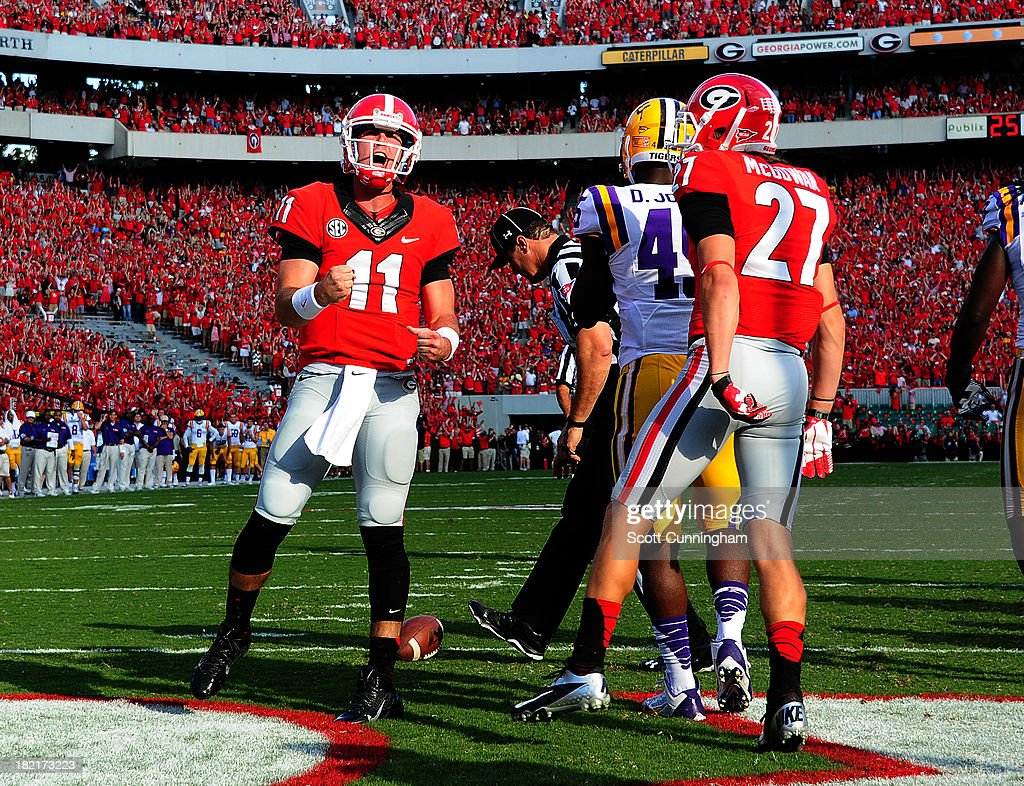 Aaron Murray #11 of the Georgia Bulldogs celebrates after scoring a second quarter touchdown against the LSU Tigers at Sanford Stadium on September 28, 2013 in Athens, Georgia.