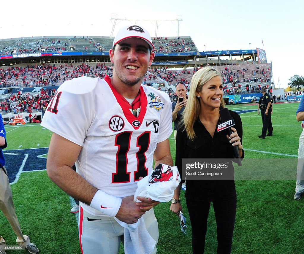 Aaron Murray #11 of the Georgia Bulldogs is interviewed by Samantha Ponder after the Capital One Bowl against the Nebraska Cornhuskers at the Citrus Bowl on January 1, 2013 in Orlando, Florida.