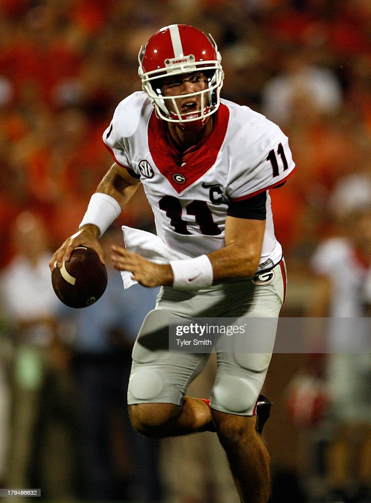 Aaron Murray #11 of the Georgia Bulldogs scrambles out of the pocket during the game against the Clemson Tigers at Memorial Stadium on August 31, 2013 in Clemson, South Carolina.