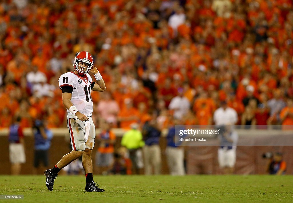 Aaron Murray #11 of the Georgia Bulldogs walks off the field against the Clemson Tigers during their game at Memorial Stadium on August 31, 2013 in Clemson, South Carolina.