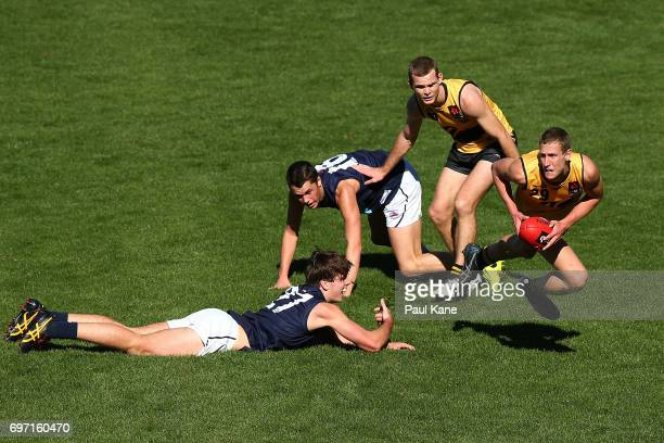 Aaron Naughton of Western Australia looks to pass the ball during the U18 Championships match between Western Australia and Victoria Metro at Domain...