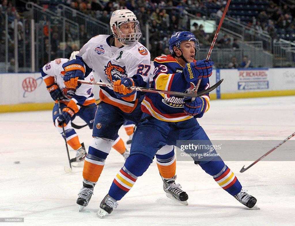 Aaron Ness #27 of the Bridgeport Sound Tigers gets his stick under Dan Sexton #23 of the Norfolk Admirals during an American Hockey League game on February 2, 2013 at the Webster Bank Arena at Harbor Yard in Bridgeport, Connecticut.