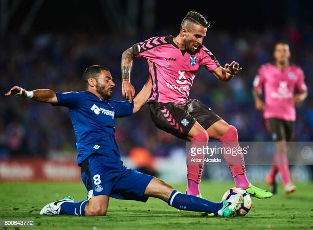 Aaron Niguez of CD Tenerife being fouled by Mehdi Laceng of Getafe CF during La Liga 2 play off round between Getafe and CD Tenerife at Coliseum...