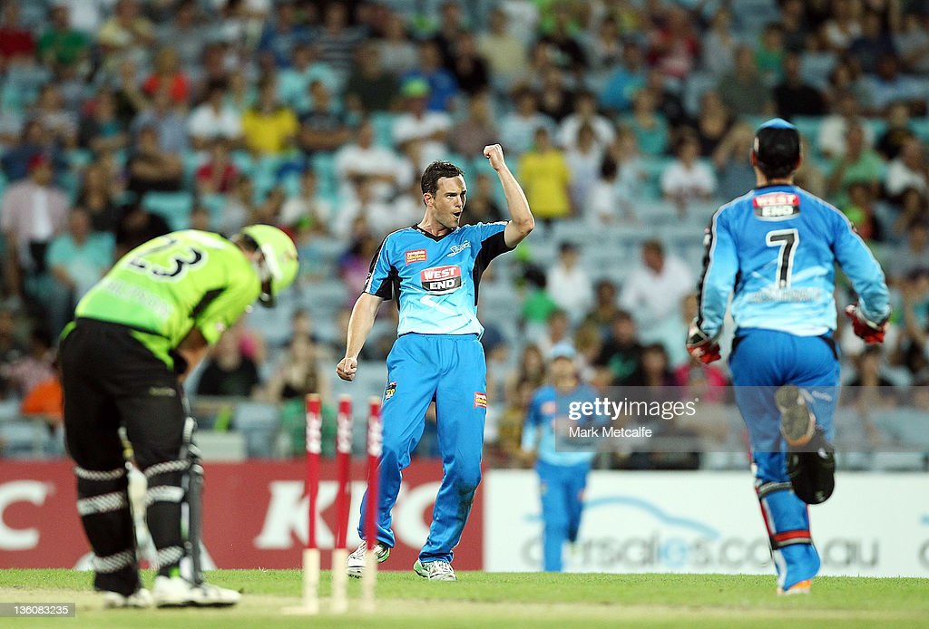 Aaron O' Brien of the Strikers celebrates bowling Craig Philipson of the Thunder during the T20 Big Bash League match between the Sydney Thunder and the Adelaide Strikers at ANZ Stadium on December 23, 2011 in Sydney, Australia.