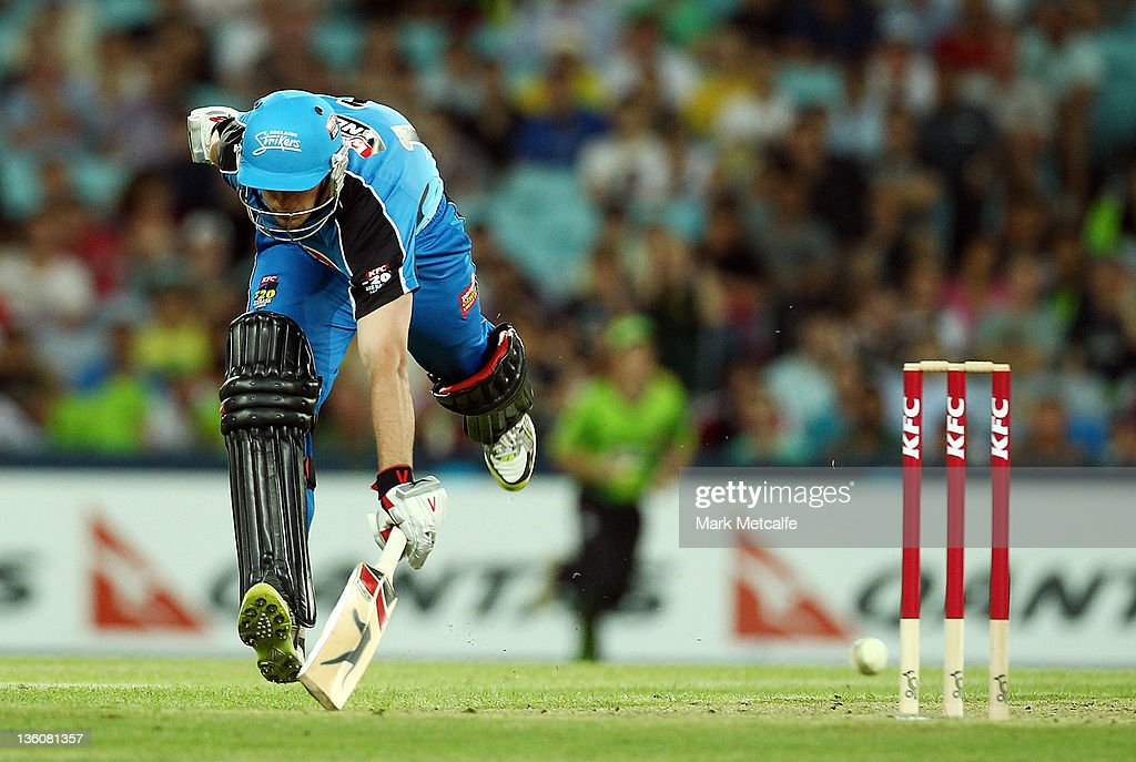 Aaron O'Brien of the Strikers jumps into the crease to avoid a runout during the T20 Big Bash League match between the Sydney Thunder and the Adelaide Strikers at ANZ Stadium on December 23, 2011 in Sydney, Australia.