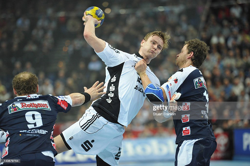 Aaron Palmarsson of Kiel is challenged by Wolfgang Strobel of Balingen during the Toyota Bundesliga match between THW Kiel and HBW Balingen-Weilstetten at the Sparkassen Arena on March 7, 2012 in Kiel, Germany.