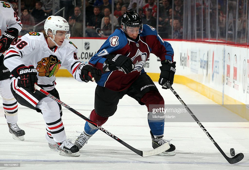 Aaron Palushaj #17 of the Colorado Avalanche skates against Patrick Kane #88 of the Chicago Blackhawks at the Pepsi Center on March 18, 2013 in Denver, Colorado. Chicago beat Colorado 5-2.