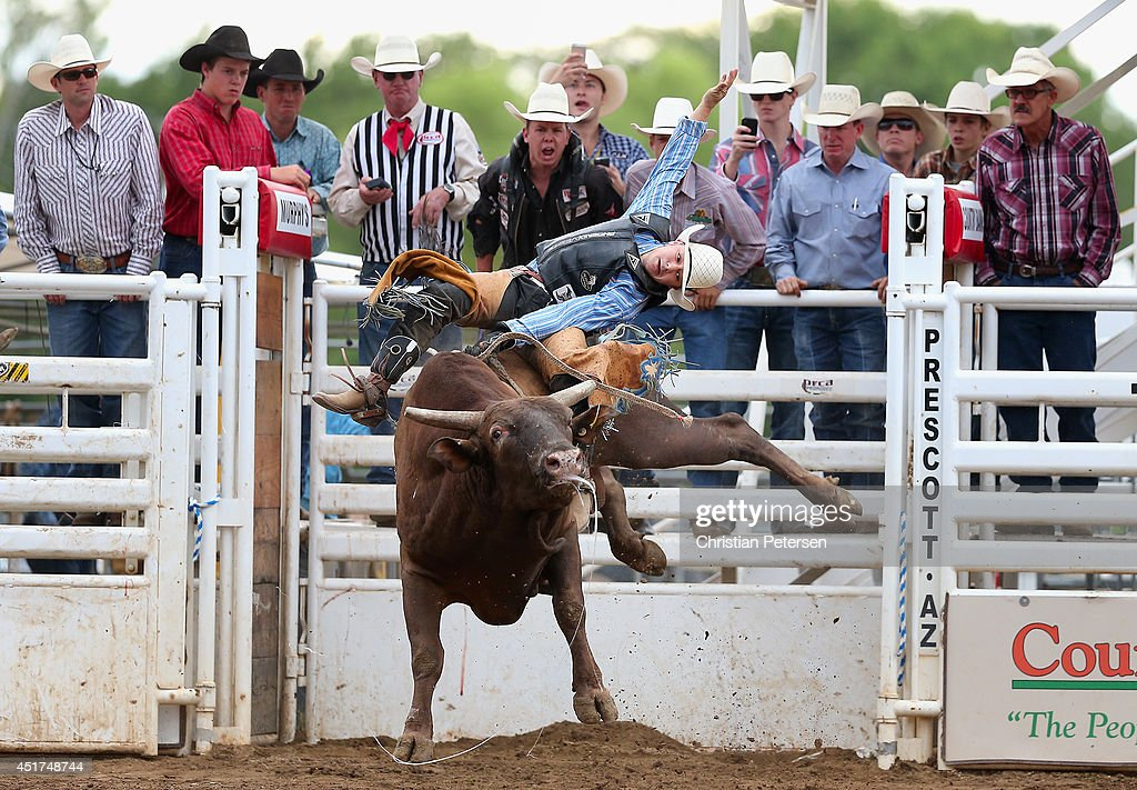 Aaron Pass competes in the Bull Riding at the Prescott Frontier Days 'World's Oldest Rodeo' on July 5, 2014 in Prescott, Arizona.