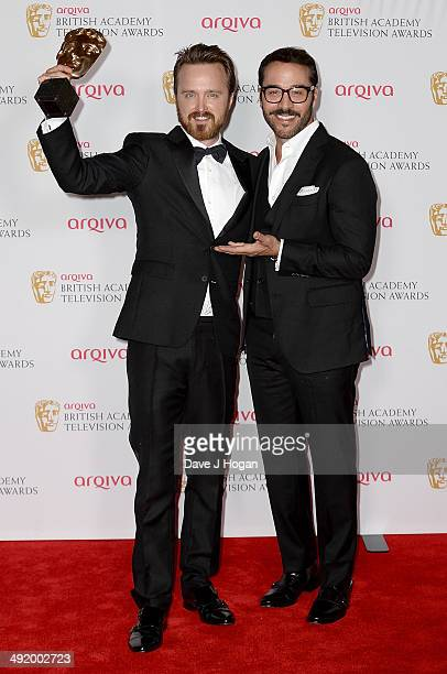Aaron Paul accepts the International Award for Breaking Bad with Jeremy Piven at the Arqiva British Academy Television Awards at Theatre Royal on May...