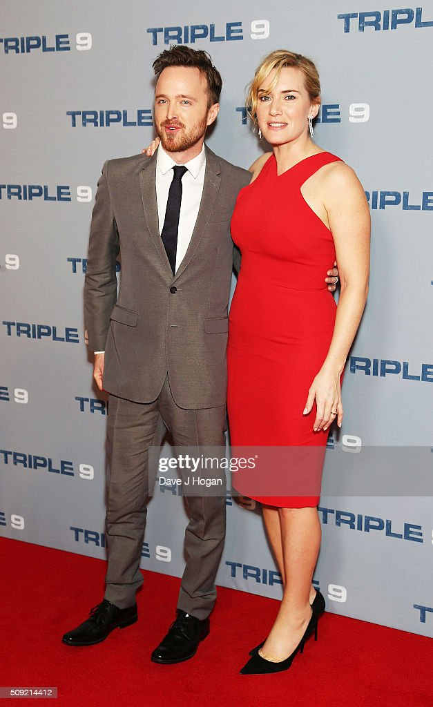 Aaron Paul (L) and <a gi-track='captionPersonalityLinkClicked' href=/galleries/search?phrase=Kate+Winslet&family=editorial&specificpeople=201923 ng-click='$event.stopPropagation()'>Kate Winslet</a> attend a special screening of 'Triple 9' at Ham Yard Hotel on February 9, 2016 in London, England.