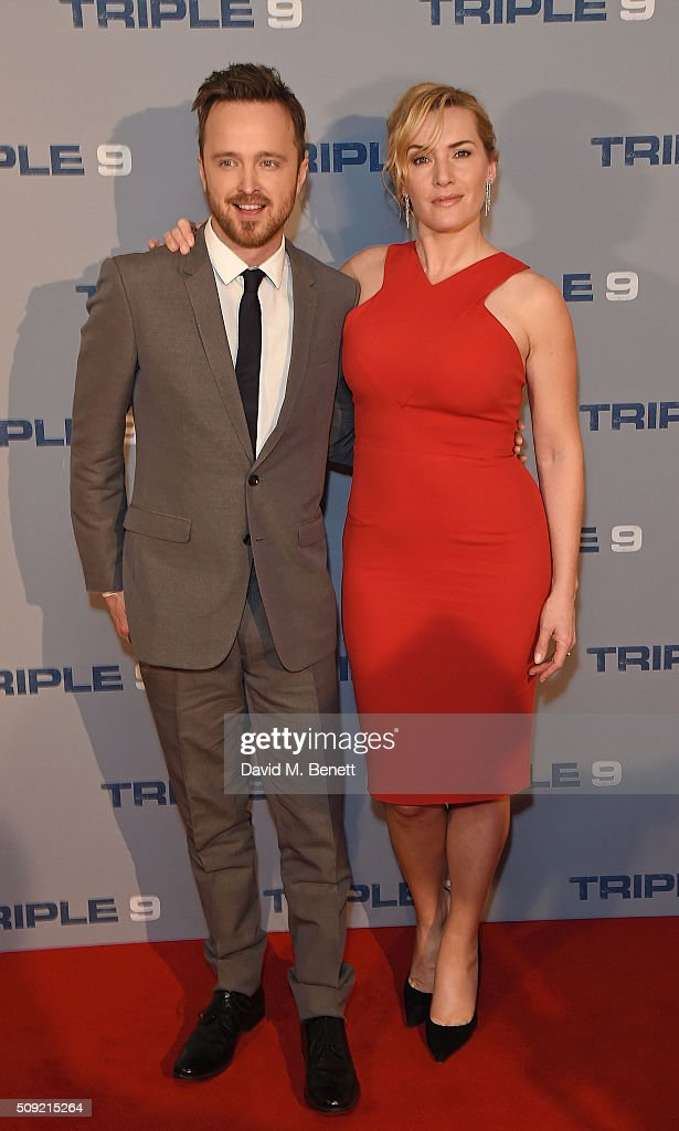 Aaron Paul and <a gi-track='captionPersonalityLinkClicked' href=/galleries/search?phrase=Kate+Winslet&family=editorial&specificpeople=201923 ng-click='$event.stopPropagation()'>Kate Winslet</a> attend a special screening of 'Triple 9' at The Ham Yard Hotel on February 9, 2016 in London, England.