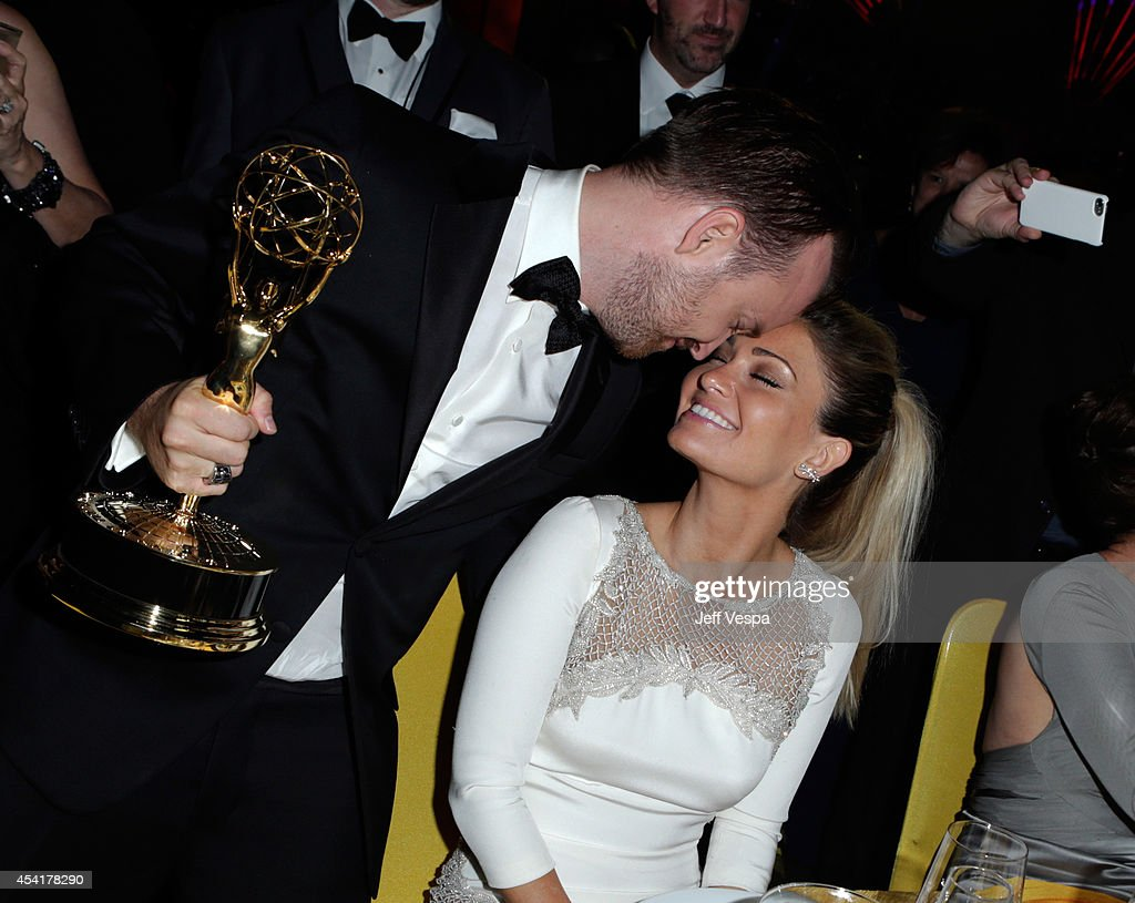 Aaron Paul and Lauren Parsekian attend the 66th Annual Primetime Emmy Awards Governors Ball held at Los Angeles Convention Center on August 25, 2014 in Los Angeles, California.