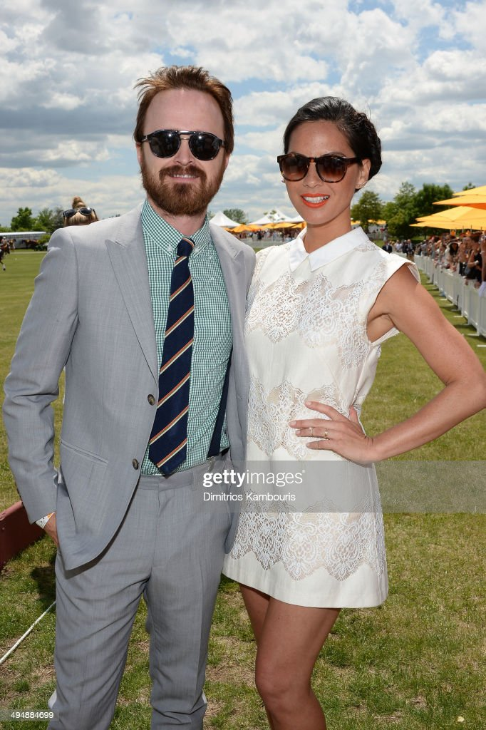Aaron Paul and Olivia Munn attend the seventh annual Veuve Clicquot Polo Classic in Liberty State Park on May 31, 2014 in Jersey City City.