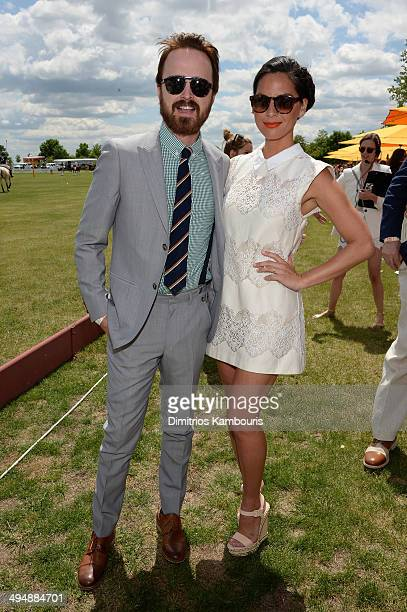 Aaron Paul and Olivia Munn attend the seventh annual Veuve Clicquot Polo Classic in Liberty State Park on May 31 2014 in Jersey City City