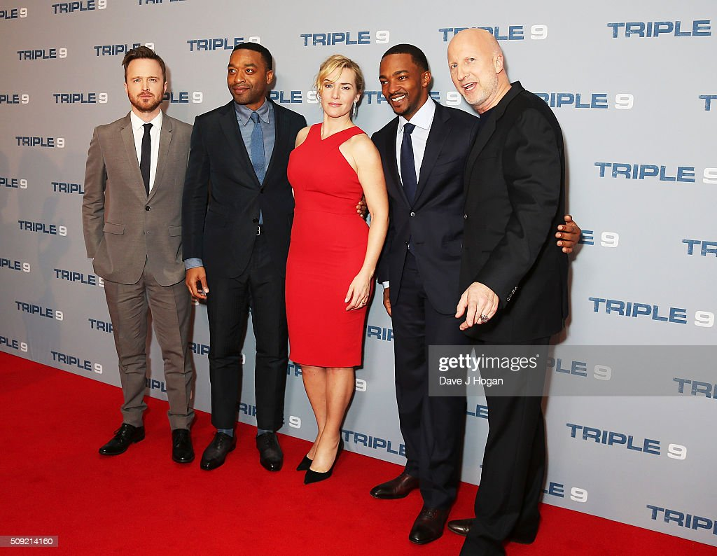 Aaron Paul, <a gi-track='captionPersonalityLinkClicked' href=/galleries/search?phrase=Chiwetel+Ejiofor&family=editorial&specificpeople=213998 ng-click='$event.stopPropagation()'>Chiwetel Ejiofor</a>, <a gi-track='captionPersonalityLinkClicked' href=/galleries/search?phrase=Kate+Winslet&family=editorial&specificpeople=201923 ng-click='$event.stopPropagation()'>Kate Winslet</a>, <a gi-track='captionPersonalityLinkClicked' href=/galleries/search?phrase=Anthony+Mackie&family=editorial&specificpeople=206212 ng-click='$event.stopPropagation()'>Anthony Mackie</a> and Director <a gi-track='captionPersonalityLinkClicked' href=/galleries/search?phrase=John+Hillcoat&family=editorial&specificpeople=665204 ng-click='$event.stopPropagation()'>John Hillcoat</a> attend a special screening of 'Triple 9' at Ham Yard Hotel on February 9, 2016 in London, England.