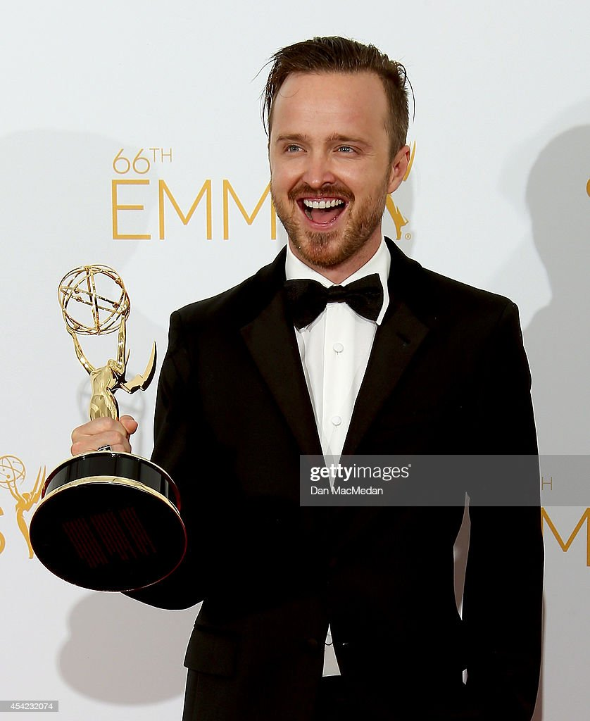 <a gi-track='captionPersonalityLinkClicked' href=/galleries/search?phrase=Aaron+Paul+-+Actor&family=editorial&specificpeople=693211 ng-click='$event.stopPropagation()'>Aaron Paul</a> poses in the photo room with his award for Outstanding Supporting Actor in a Drama Series for 'Breaking Bad' at Nokia Theatre L.A. Live on August 25, 2014 in Los Angeles, California.