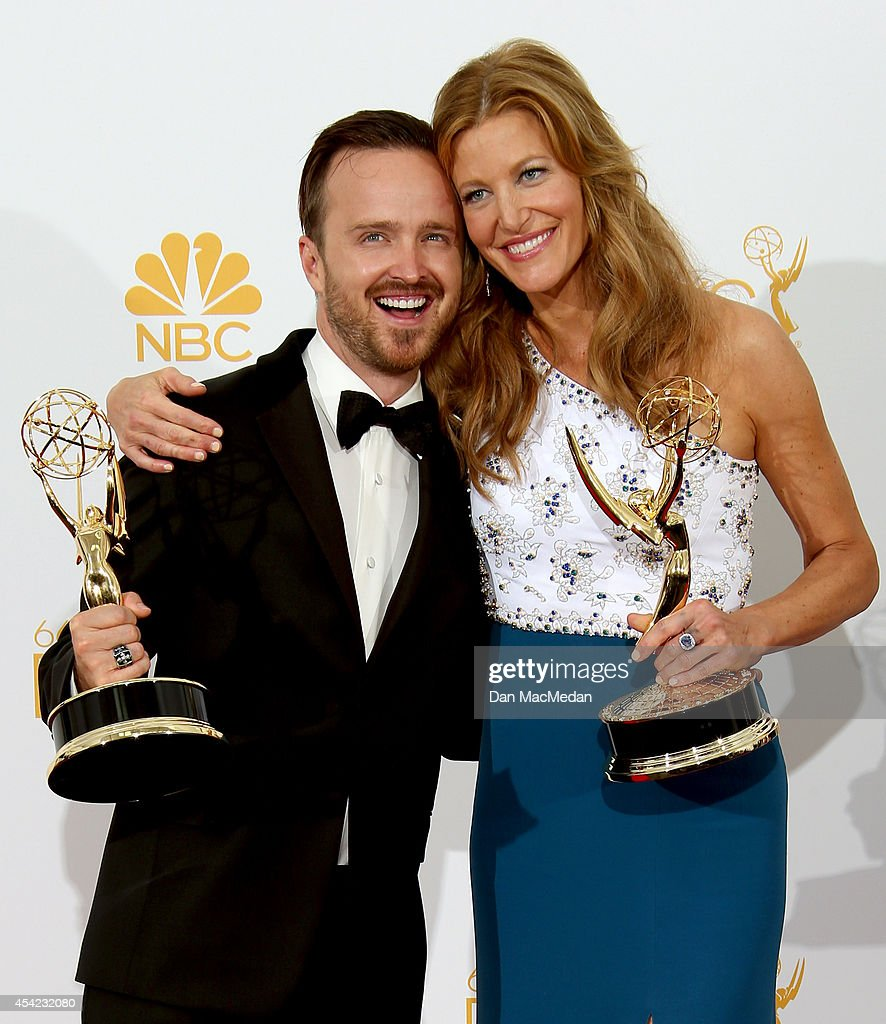 Aaron Paul (L), winner for Outstanding Supporting Actor in a Drama Series and Anna Gunn, winner for Outstanding Supporting Actress in a Drama Series, for 'Breaking Bad' pose in the press room at Nokia Theatre L.A. Live on August 25, 2014 in Los Angeles, California.