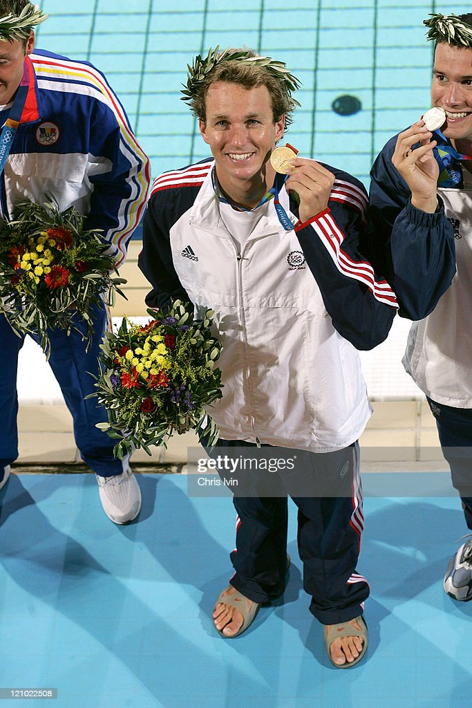 Aaron Peirsol of United States of America celebrates after winning 200m backstroke final with a new Olympic record time of 1:54.95, during Athens 2004 Olympic Games in Athens , Greece on August 19, 2004.