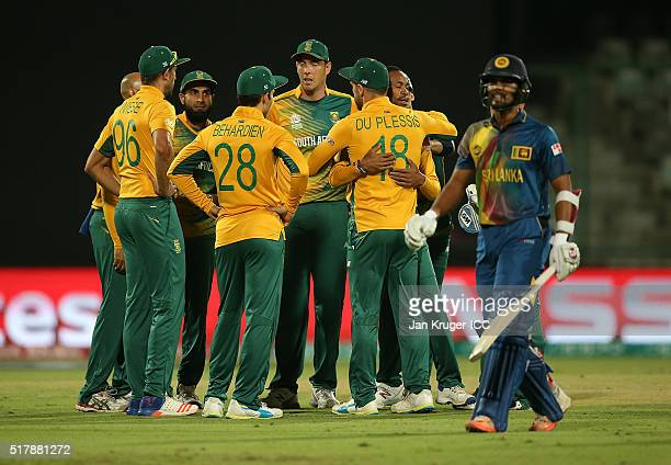 Aaron Phangiso of South Africa celebrates the wicket of Dinesh Chandimal of Sri Lanka with team mates during the ICC World Twenty20 India 2016 Super...