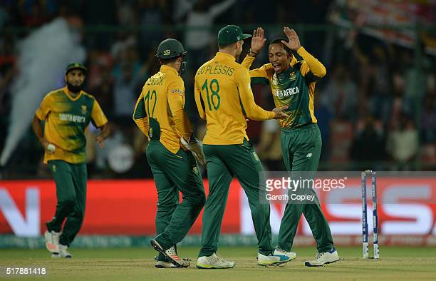 Aaron Phangiso of South Africa celebrates with captain Faf du Plessis after dismissing Lahiru Thirimanne of Sri Lanka during the ICC World Twenty20...