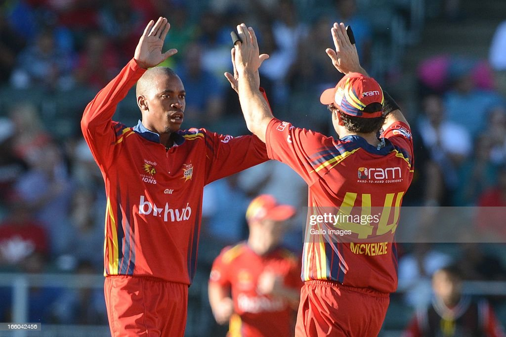 <a gi-track='captionPersonalityLinkClicked' href=/galleries/search?phrase=Aaron+Phangiso&family=editorial&specificpeople=7184692 ng-click='$event.stopPropagation()'>Aaron Phangiso</a> of the Bizhub Highveld Lions celebrates the wicket of Heino Kuhn with team-mate <a gi-track='captionPersonalityLinkClicked' href=/galleries/search?phrase=Neil+McKenzie+-+Cricket+Player&family=editorial&specificpeople=2224176 ng-click='$event.stopPropagation()'>Neil McKenzie</a> during the 2013 RAM Slam T20 Challenge Final between Bizhub Highveld Lions and Nashua Titans at Bidvets Wanderers Stadium on April 07, 2013 in Johannesburg, South Africa.
