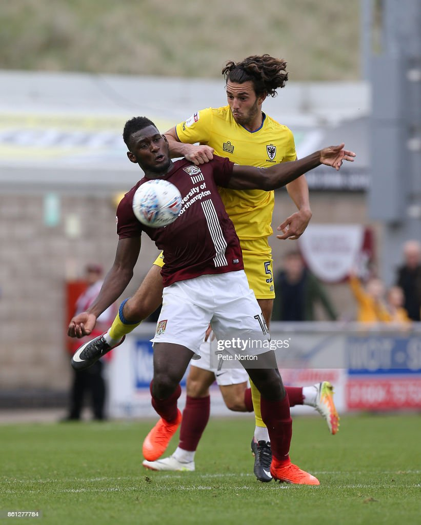Aaron Pierre of Northampton Town attempts to control the ball under pressure from Will Nightingale of AFC Wimbledon during the Sky Bet League One match between Northampton Town and A.F.C. Wimbledon at Sixfields on October 14, 2017 in Northampton, England.