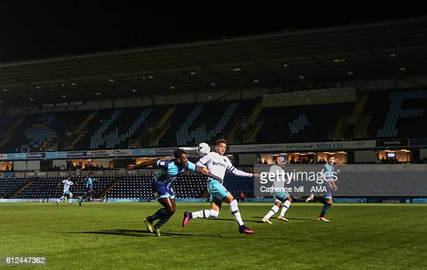 Aaron Pierre of Wycombe Wanderers and Marcus Browne of West Ham during the Checkatrade trophy match between Wycombe Wanderers and West Ham United at...