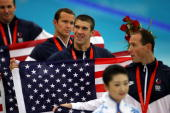 Aaron Piersol Brendan Hansen Michael Phelps and Jason Lezak of the United States celebrate their gold medals in the Men's 4x100 Medley Relay at the...