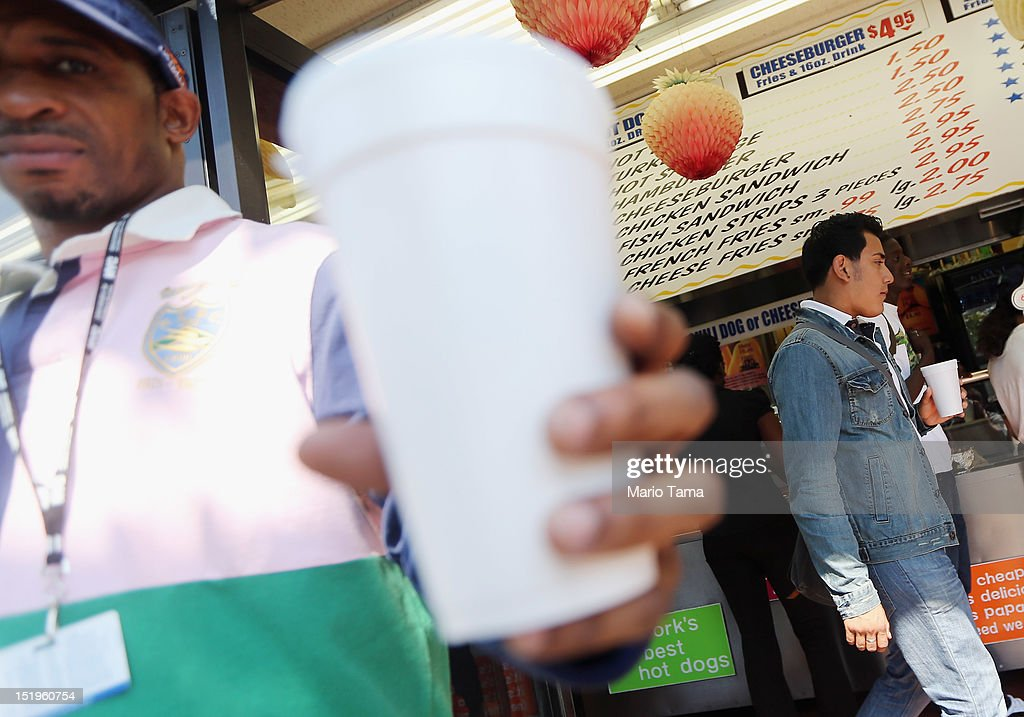 Aaron Porter poses with his 21 ounce cup of soda at a Manhattan fast food restaurant on September 13, 2012 in New York City. In an effort to combat obesity, the New York City Board of Health voted to ban the sale of large sugary drinks. The controversial measure bars the sale of sugar drinks larger than 16 ounces at restaurants and concessions.