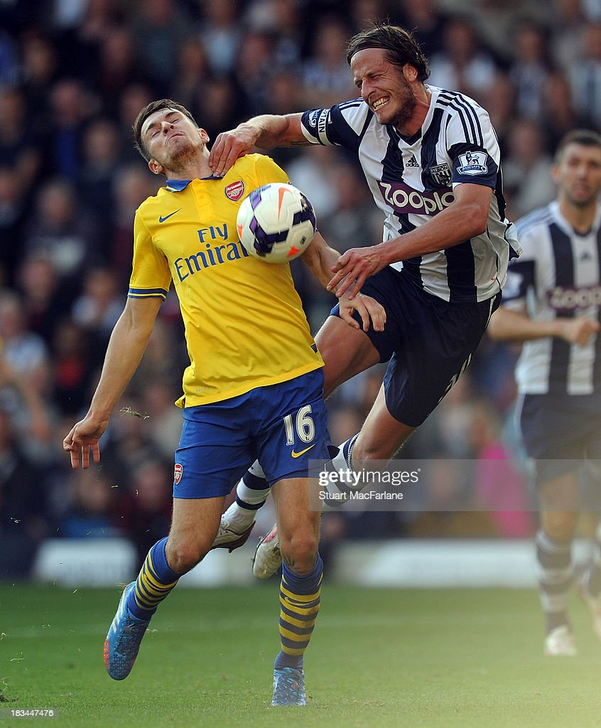 Aaron Ramey of Arsenal in action against Jonas Olsson of West Bromwich Albion during the Barclays Premier League match between West Bromwich Albion and Arsenal FC at The Hawthorns on October 6, 2013 in West Bromwich, England.