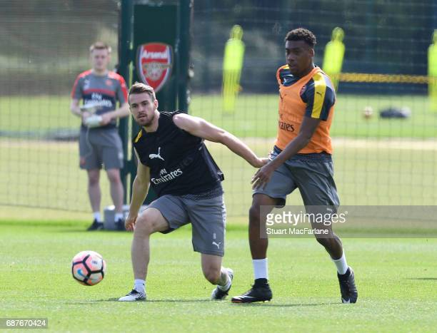 Aaron Ramsey and Alex Iwobi of Arsenal during a training session at London Colney on May 24 2017 in St Albans England