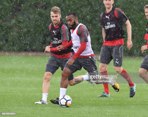 Aaron Ramsey and Alex Lacazette of Arsenal during a training session at London Colney on August 18 2017 in St Albans England