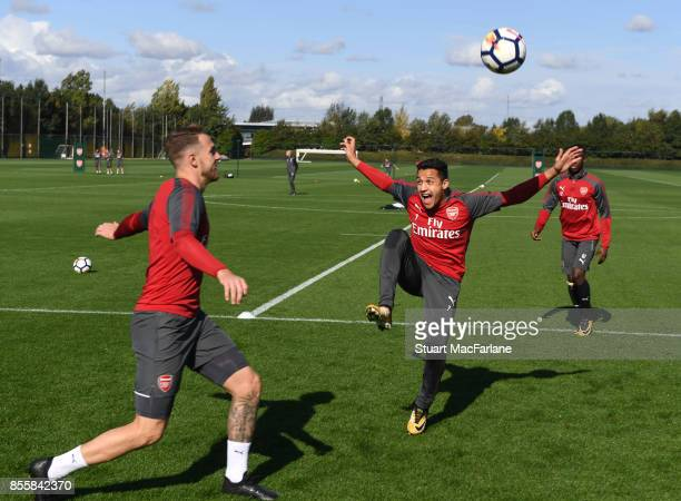 Aaron Ramsey and Alexis Sanchez of Arsenal during a training session at London Colney on September 30 2017 in St Albans England