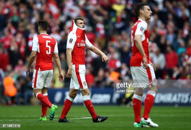 Aaron Ramsey and Arsenal players react after Manchester City's first goal during the Emirates FA Cup SemiFinal match between Arsenal and Manchester...