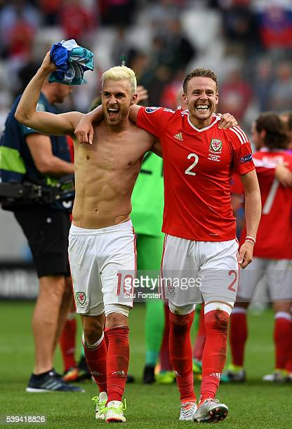 Aaron Ramsey and Chris Gunter of Wales celebrate their team's 21 win in the UEFA EURO 2016 Group B match between Wales and Slovakia at Stade Matmut...