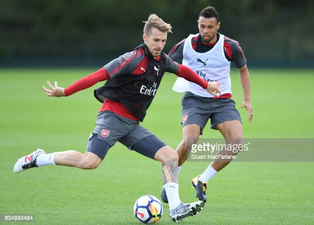 Aaron Ramsey and Francis Coquelin of Arsenal during a training session at London Colney on August 18 2017 in St Albans England