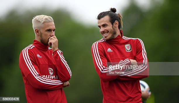 Aaron Ramsey and Gareth Bale share a joke during Wales training at the Vale hotel complex on June 1 2016 in Cardiff Wales