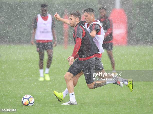 Aaron Ramsey and Granit Xhaka of Arsenal during a training session at London Colney on August 18 2017 in St Albans England