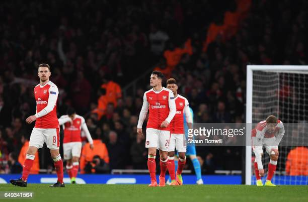 Aaron Ramsey and Granit Xhaka of Arsenal look dejected during the UEFA Champions League Round of 16 second leg match between Arsenal FC and FC Bayern...