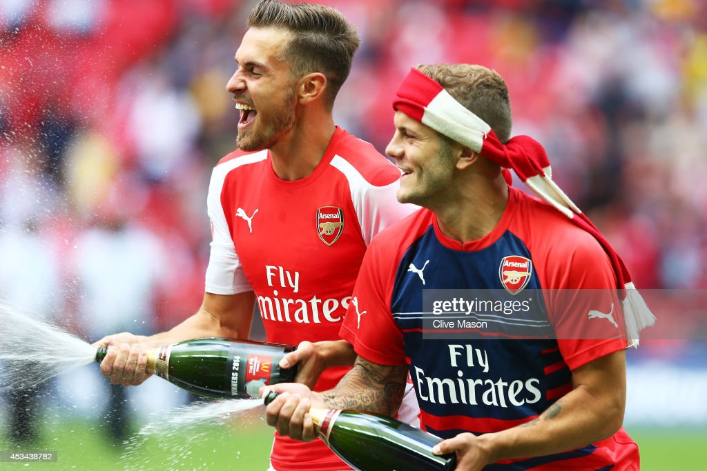 <a gi-track='captionPersonalityLinkClicked' href=/galleries/search?phrase=Aaron+Ramsey&family=editorial&specificpeople=4784114 ng-click='$event.stopPropagation()'>Aaron Ramsey</a> and <a gi-track='captionPersonalityLinkClicked' href=/galleries/search?phrase=Jack+Wilshere&family=editorial&specificpeople=5446655 ng-click='$event.stopPropagation()'>Jack Wilshere</a> of Arsenal celebrate their win during the FA Community Shield match between Manchester City and Arsenal at Wembley Stadium on August 10, 2014 in London, England.