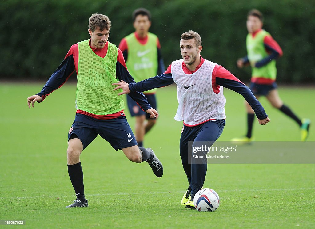 <a gi-track='captionPersonalityLinkClicked' href=/galleries/search?phrase=Aaron+Ramsey&family=editorial&specificpeople=4784114 ng-click='$event.stopPropagation()'>Aaron Ramsey</a> and <a gi-track='captionPersonalityLinkClicked' href=/galleries/search?phrase=Jack+Wilshere&family=editorial&specificpeople=5446655 ng-click='$event.stopPropagation()'>Jack Wilshere</a> of Arsenal in action during a training session at London Colney on October 28, 2013 in St Albans, England.