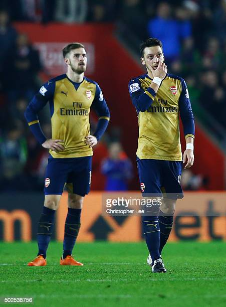 Aaron Ramsey and Mesut Ozil of Arsenal look dejected during the Barclays Premier League match between Southampton and Arsenal at St Mary's Stadium on...
