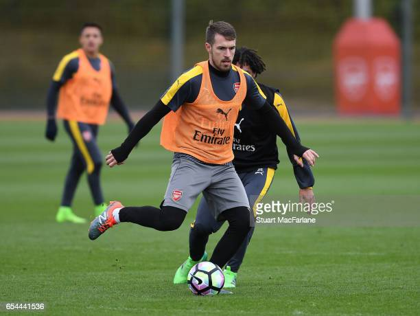 Aaron Ramsey and Mohamed Elneny of Arsenal during a training session at London Colney on March 17 2017 in St Albans England