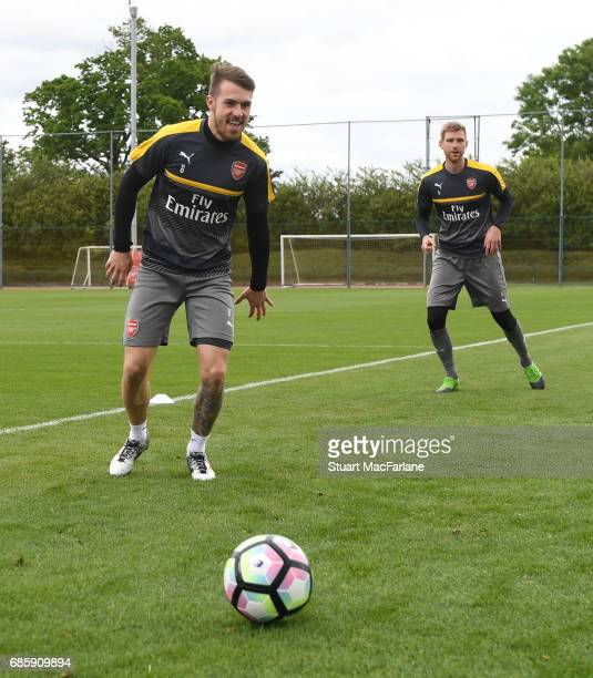 Aaron Ramsey and Per Mertesacker of Arsenal during a training session at London Colney on May 20 2017 in St Albans England