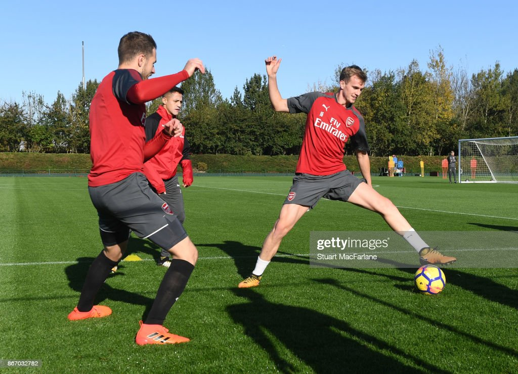 Aaron Ramsey and Rob Holding of Arsenal during a training session at London Colney on October 27, 2017 in St Albans, England.
