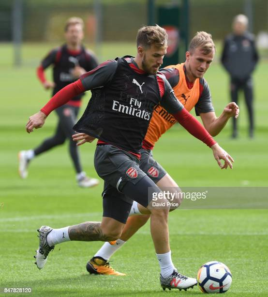 Aaron Ramsey and Rob Holding of Arsenal during Arsenal 1st team training session at London Colney on September 16 2017 in St Albans England