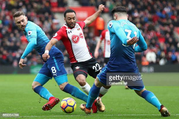 Aaron Ramsey and Sead Kolasinac of Arsenal battle for possession with Nathan Redmond of Southampton during the Premier League match between...