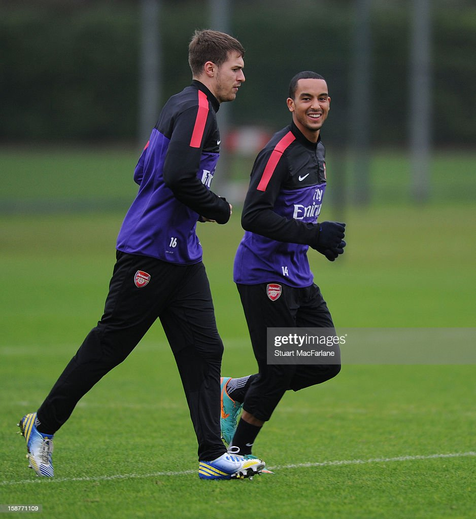 Aaron Ramsey and Theo Walcott of Arsenal during a training session at London Colney on December 28, 2012 in St Albans, England.