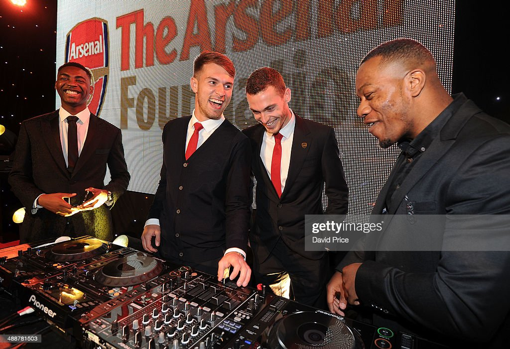 Aaron Ramsey and Thomas Vermaelen of Arsenal with Rudimental at the Arsenal Charity Ball at Emirates Stadium on May 8 2014 in London England