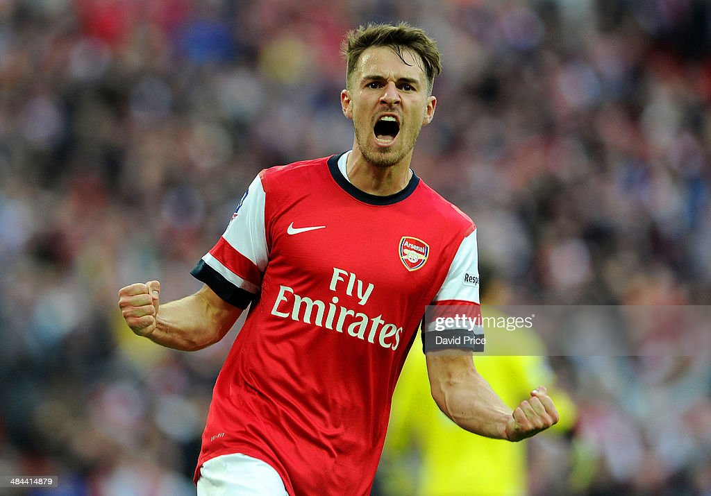 <a gi-track='captionPersonalityLinkClicked' href=/galleries/search?phrase=Aaron+Ramsey+-+Soccer+Player&family=editorial&specificpeople=4784114 ng-click='$event.stopPropagation()'>Aaron Ramsey</a> celebrates Arsenal's 1st goal during the match between Arsenal and Wigan Athletic in the FA Cup Semi Final at Wembley Stadium on April 12, 2014 in London, England.